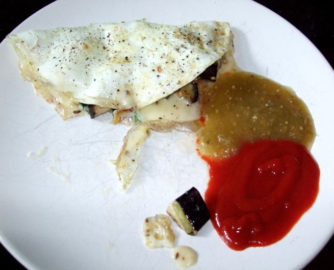 from left: egg white omelette with eggplant, spinach and havarti, salsa verde, and sriracha sauce