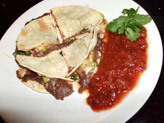 from left: tostada, chipotle salsa with cilantro garnish