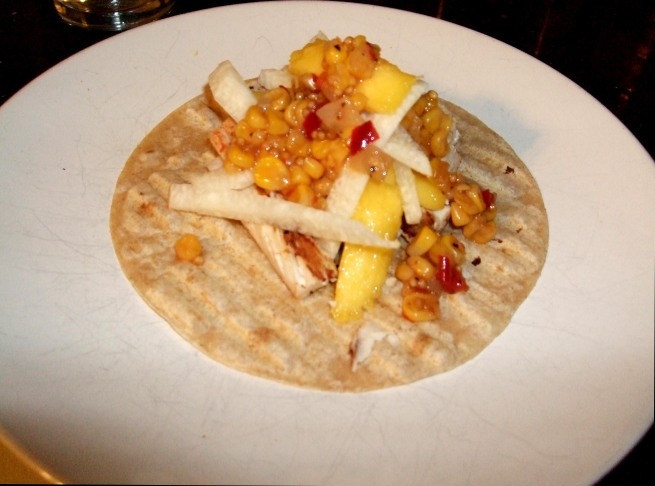 fish taco with mango-jicama slaw and corn chile salsa