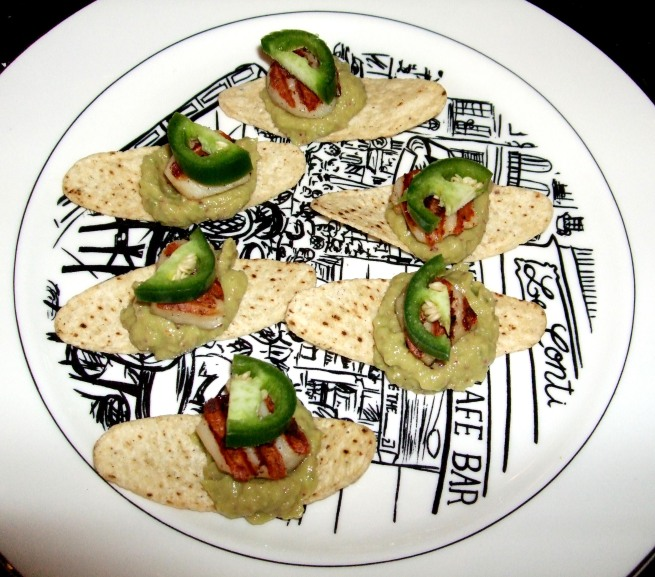 grilled scallops on tortilla chips w/ avocado puree