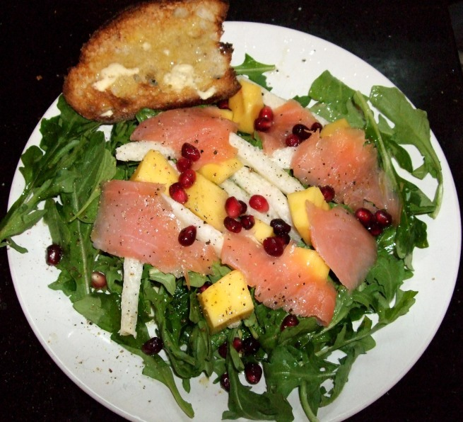 arugula salad with salmon, jicama, mango and pomegranate seeds