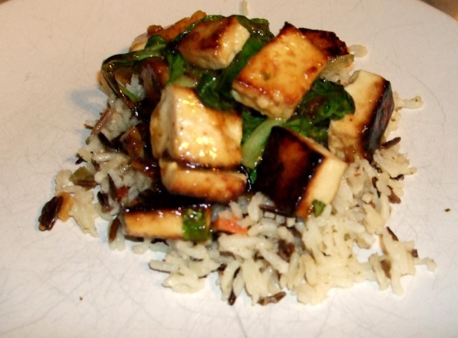tofu and bok choy atop basmati rice with spicy peanut vinaigrette