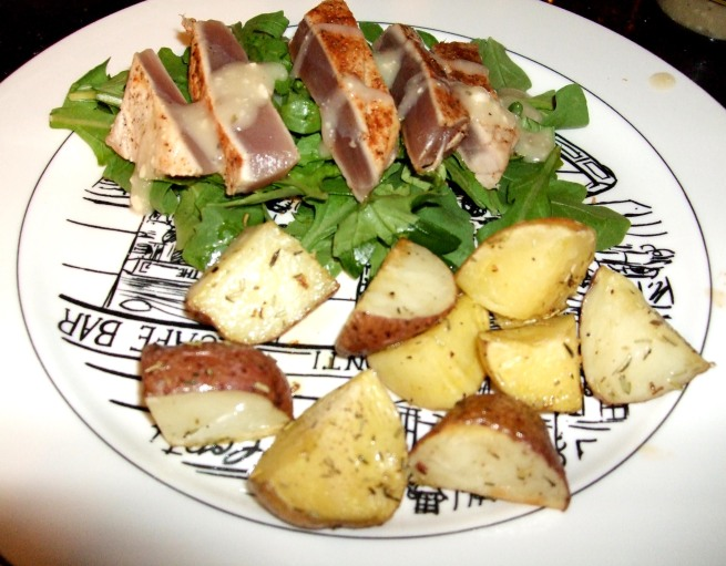 seared Ahi tuna on arugula, herb roasted potatoes