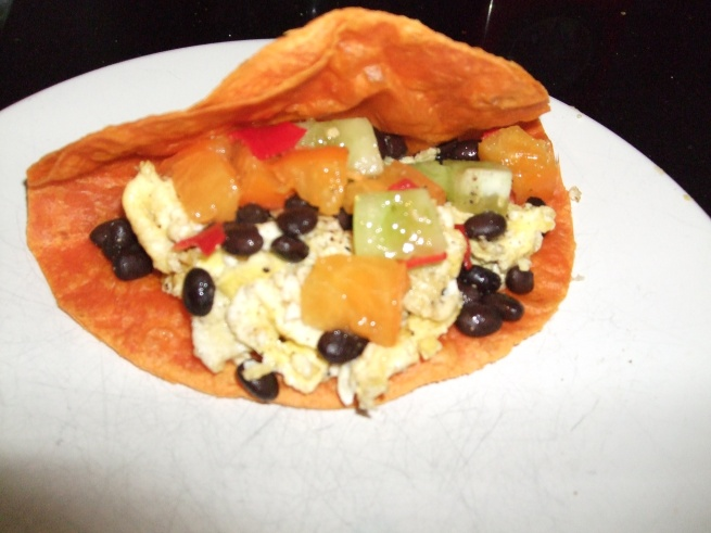 breakfast taco with scrambled egg, black beans, and mixed tomato salsa with serrano chile pepper