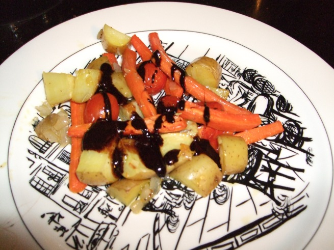 roasted potatoes and veggies in a balsamic honey reduction